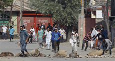 Indian Police Expand Curfew in Kashmir, Block Protest Rally