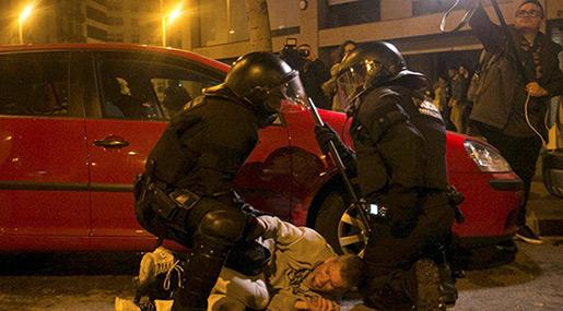 Violent Clashes Erupt Across Catalonia After Puigdemont's Arrest