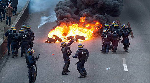 May Day Riot: Masked Protesters Torch Cars As Paris Police Deploy Tear Gas, Arrest 200