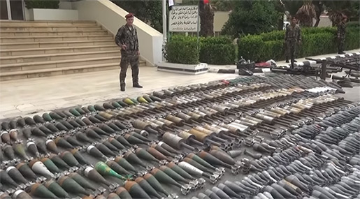 «Israeli»-Made Weapons among Arms Handed Over By Militants in Damascus