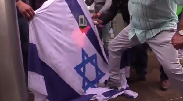 """Israeli"" flag being burned in a UK protest"