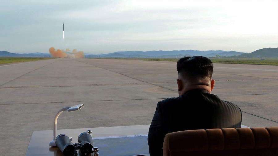 North Korean leader Kim Jong-un watches the launch of a ballistic missile