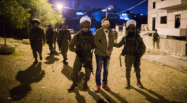 "Palestinian detained by ""Israeli"" forces"