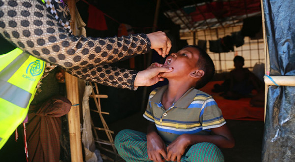 A Rohingya boy receives one of the first Cholera vaccine