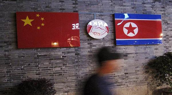 North Korea and China flags