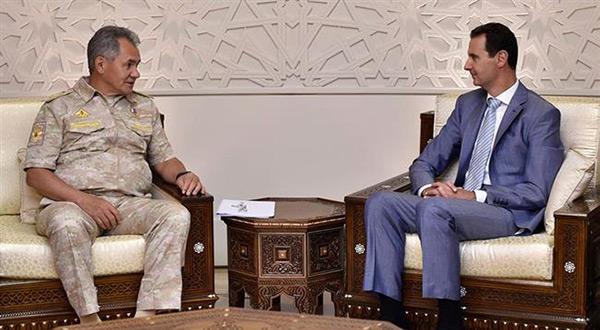 Syrian President Bashar al-Assad and Russian Defense Minister Sergei Shoigu