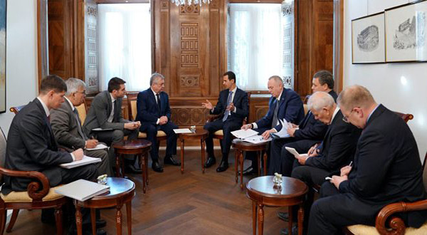 Syrian President Bashar al-Assad and the Russian delegation