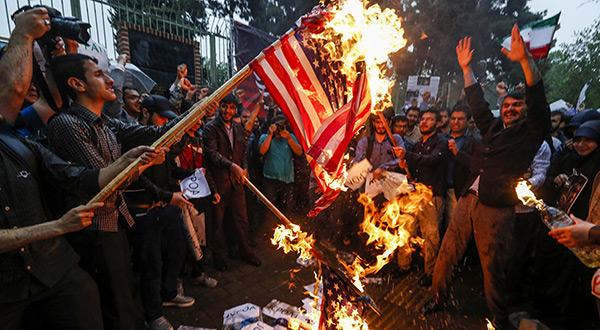 Iranians burning American flag