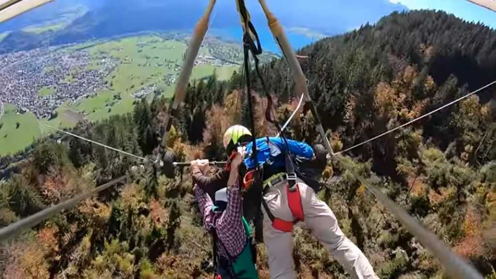 Man Hangs on to Glider at 1000+ Meters after Pilot Fails to Attach Harness