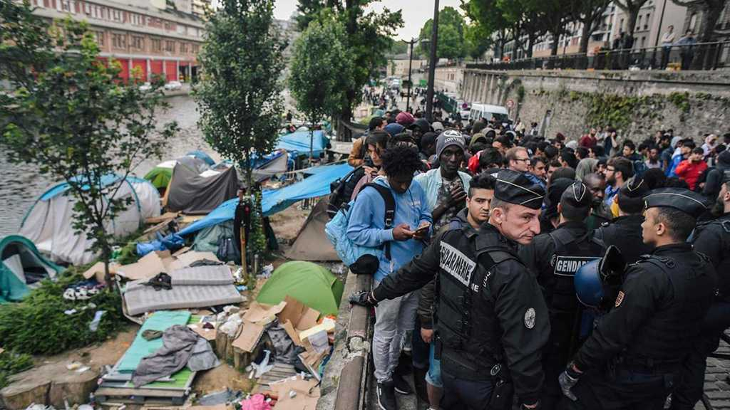 France: Police Evacuate Some 500 Migrants from Camp North of Capital