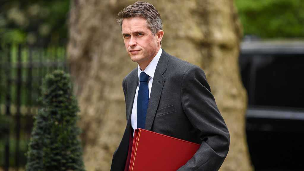 May Fires UK Defense Minister Williamson over Huawei Leak
