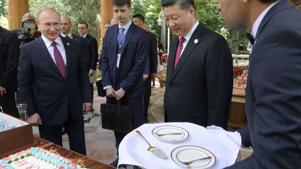 Putin Presents China's Xi Jinping with Russian Ice Cream on His Birthday