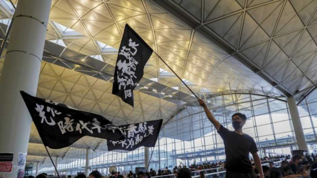 Hong Kong Crisis: Airport Struggles to Reopen, US Announces Support for Protestors