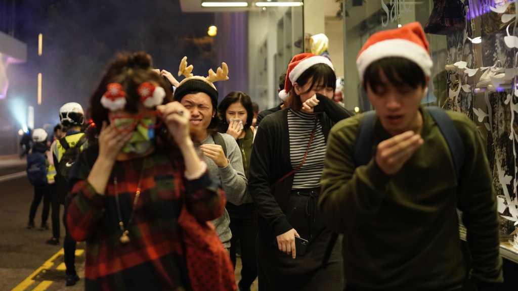 Hong Kong: Protesters, Police Clash on Christmas Eve