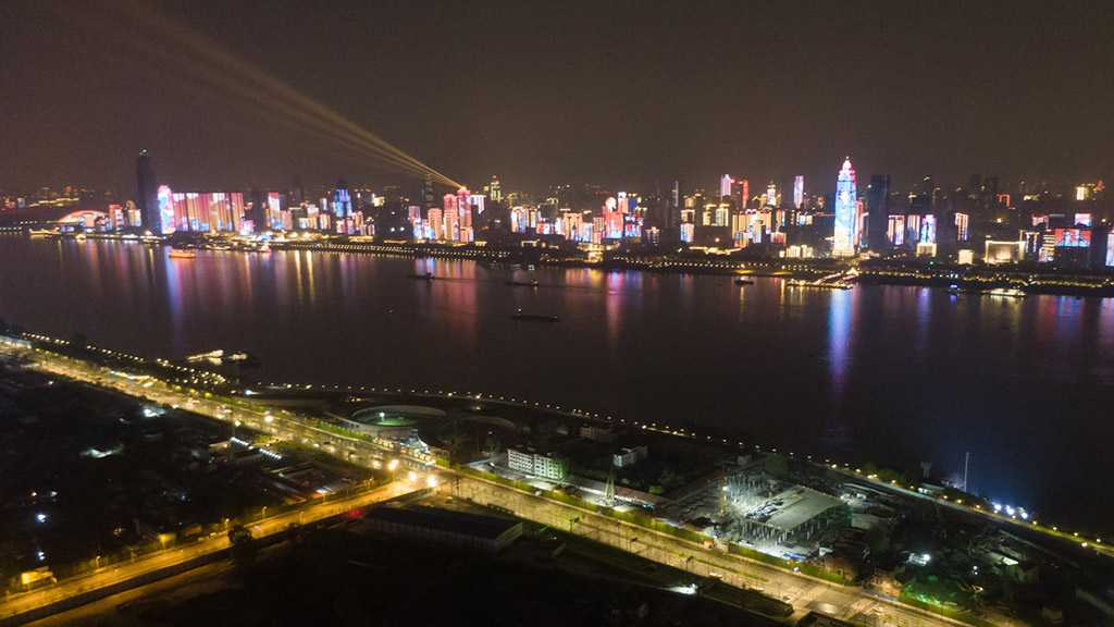 Wuhan Aglow As Outbound Travel Ban Lifted