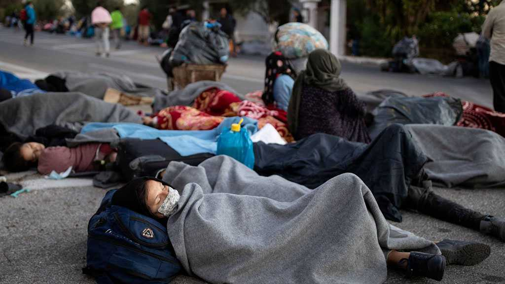 Hungry Refugees Sleep Rough on Lesbos Island after Moria Fire