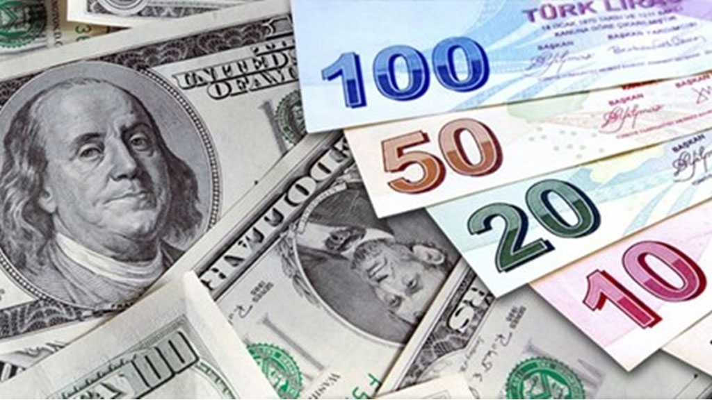 Turkish Lira Slides to Record Low of 8 against Dollar