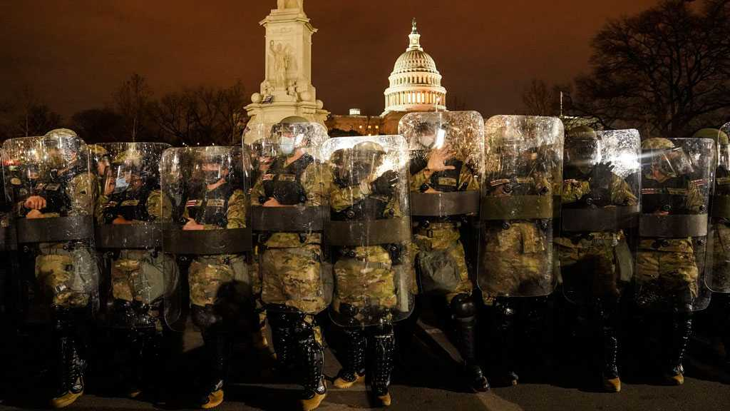 US Senate Reconvenes for Electoral College Vote Count with Heavily Armed Guards After Capitol Siege