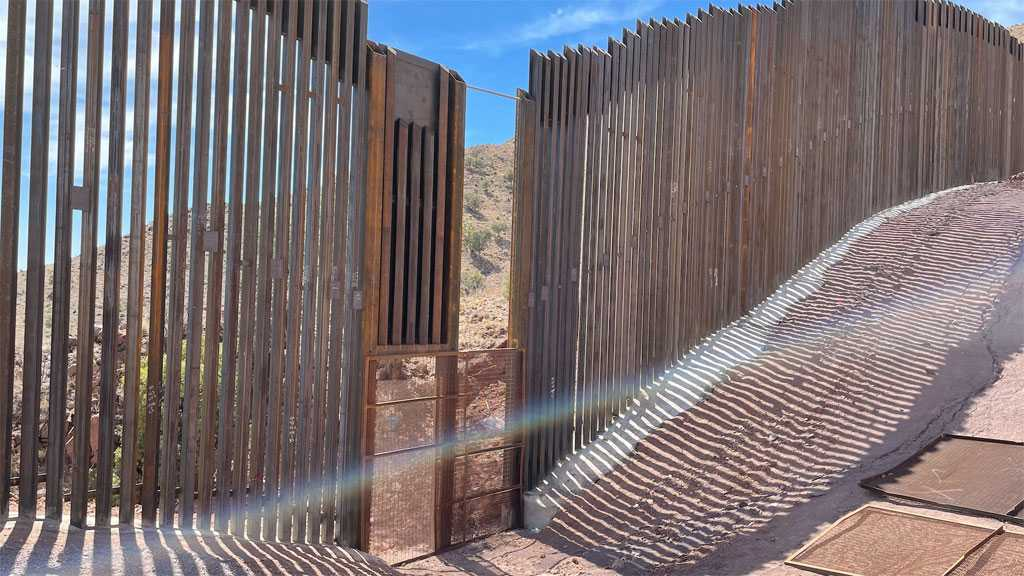 'Legions of Migrants' Using Border Wall's Unfinished Sections to Enter US