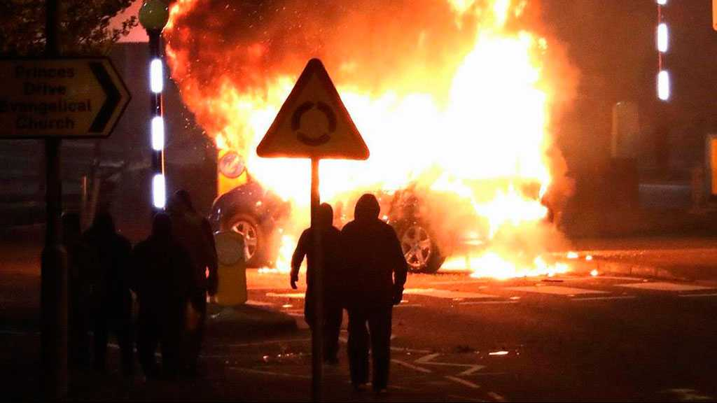 Burning Car Rams into Police Line as Nightly Rioting Continues in Belfast