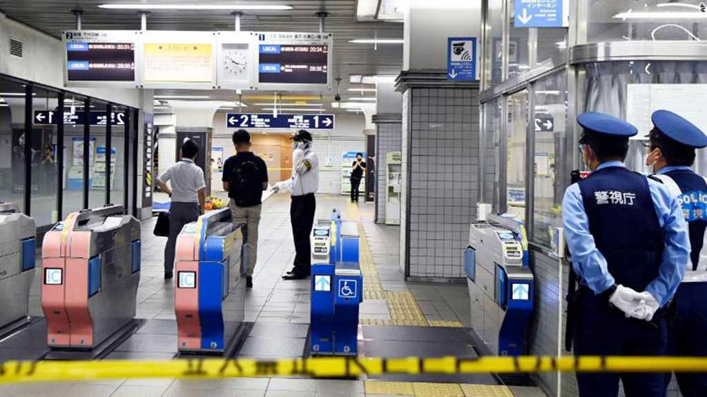 """Knife Attacker Who Injured 10 on Tokyo Train Wanted to Kill """"Happy Women"""""""